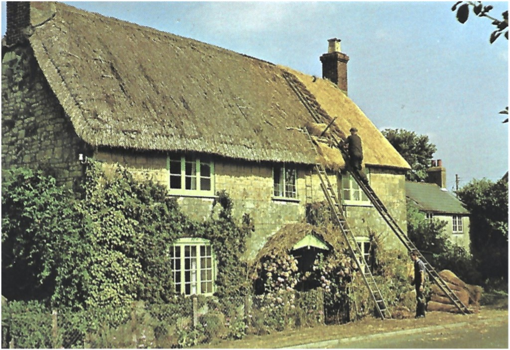 98 Kitt Hill being re-thatched.